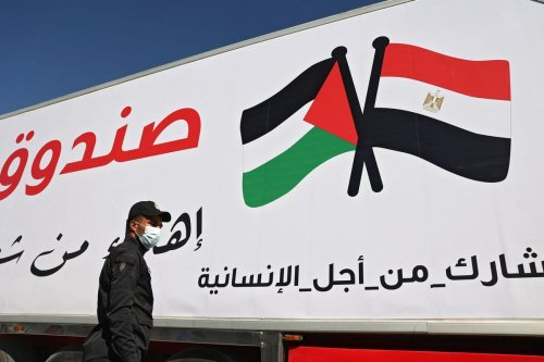 Egyptin and Palestinian flag seen on an aid truck at the Rafah crossing with Gaza on 23 May 2-2021 [SAID KHATIB/AFP/Getty Images]