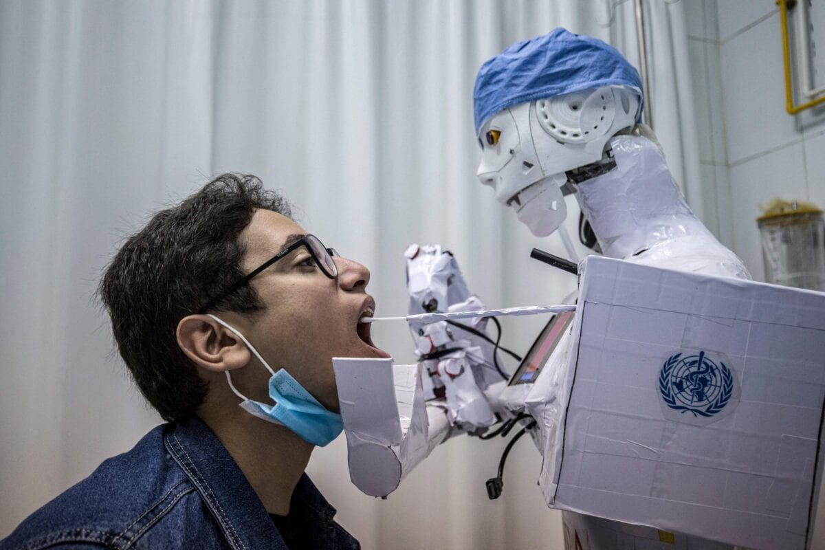 A robot to assist physicians in running tests on suspected COVID-19 coronavirus patients at a private hospital in Egypt's Nile delta city of Tanta, on March 20, 2021 [KHALED DESOUKI/AFP via Getty Images]