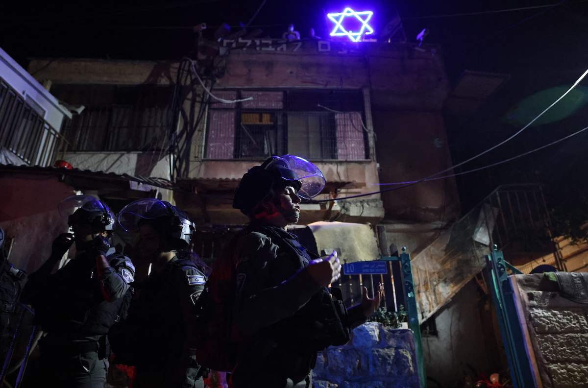 Israeli riot policemen during a demonstration as Palestinian families face eviction, part of an ongoing effort by Jewish Israelis to take control of homes in the Sheikh Jarrah neighbourhood of occupied east Jerusalem, on May 5, 2021. [EMMANUEL DUNAND/AFP via Getty Images]