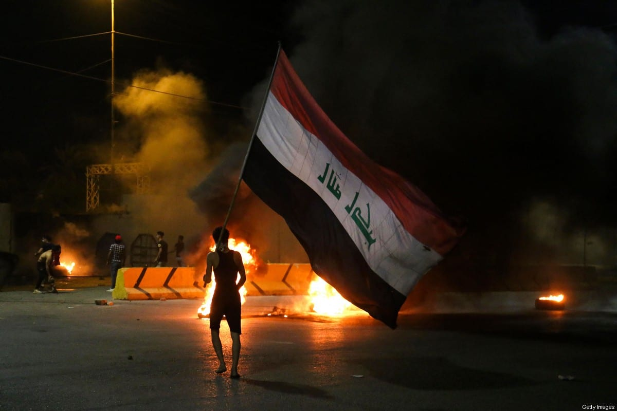 Iraqi protesters burn tyres in Baghdad, Iraq on 9 May 2021 [MOHAMMED SAWAF/AFP/ Getty Images]