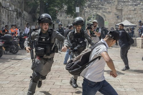Israeli police run after a Palestinian demonstrator at the Al-Aqsa Mosque during Israel's 'Jerusalem Day' on May 10, 2021 in Jerusalem, Israel [Laurent Van Der Stockt/Getty Images]