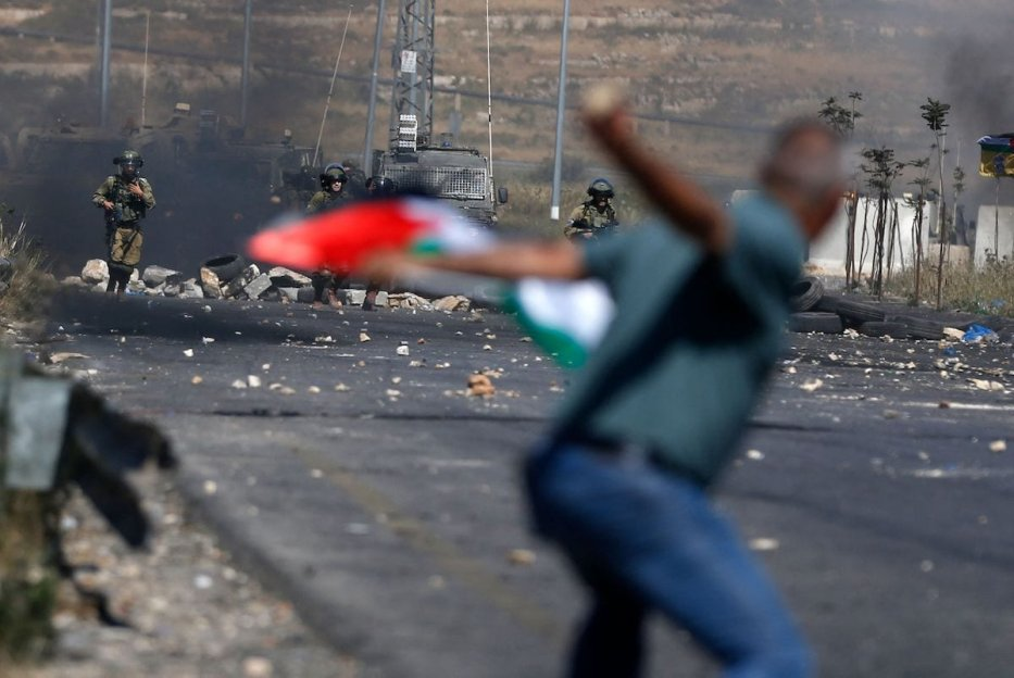 A Palestinian demonstrator during demonstrations near the Jewish settlement of Beit El near Ramallah in the occupied West Bank on May 14, 2021. [ABBAS MOMANI/AFP via Getty Images]