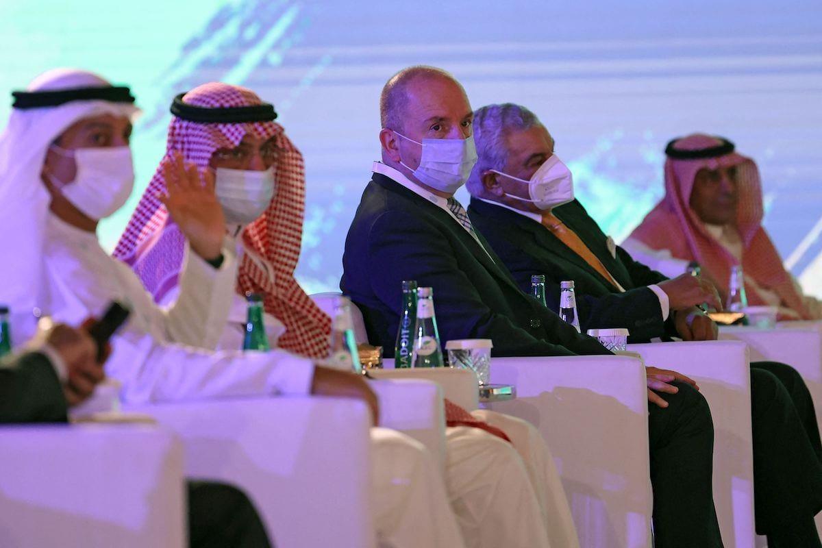 Syrian Tourism Minister Mohammed Rami Martini (C) attends a tourism conference in the Saudi capital Riyadh on 26 May 2021, despite tense relations between the two countries. [FAYEZ NURELDINE/AFP via Getty Images]