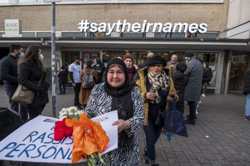 Relatives, friends and witnesses meet in front of and in the rooms of the victims' initiative 'saytheirnames' near the first crime scene at Heumarkt on the shooting's first anniversary on February 19, 2021 in Hanau, Germany [Thomas Lohnes/Getty Images]