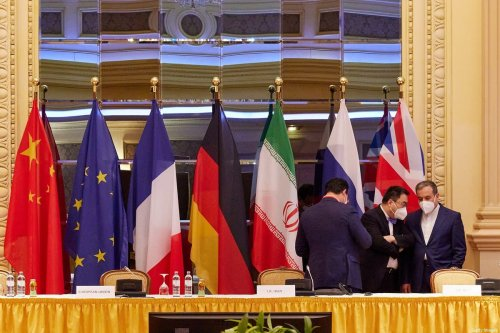 VIENNA, AUSTRIA - APRIL 27: In this handout image provide by EU Delegation Vienna, Iranian Deputy Foreign Minister Abbas Araghchi (R) speaks with other participants at the JCPOA Iran nuclear talks on April 27, 2021 in Vienna, Austria. Representatives from the United States, Iran, the European Union and other participants from the original Joint Comprehensive Plan of Action (JCPOA) are meeting both directly and indirectly over possibly reviving the plan. The JCPOA was the European-led initiative by which Iran agreed not to pursue a nuclear weapon in exchange for concessions, though the United States, under the administration of former U.S. President Donald Trump, abandoned the deal and intensified sanctions against Iran. (Photo by EU DELEGATION VIENNA via Getty Images)