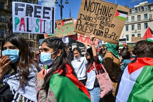 Protestors have gathered in solidarity with the people of Palestine amid ongoing conflict in Gaza on May 16, 2021 in Glasgow, Scotland [Jeff J Mitchell/Getty Images]