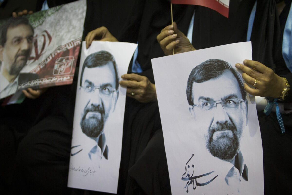 Supporters of Iranian presidential candidate, conservative former chief of the Revolutionary Guards Mohsen Rezai, hold posters bearing his portrait during a campaign rally on June 10, 2013 in downtown Tehran, Iran [Majid Saeedi/Getty Images]