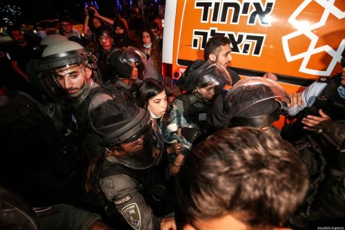 Israeli forces take a Palestinian woman into custody during a demonstration at Sheikh Jarrah neighborhood after Israeli government's plan to force some Palestinian families out of their homes in East Jerusalem on May 05, 2021 [Mostafa Alkharouf/Anadolu Agency]
