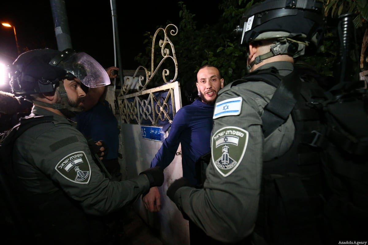 Israeli forces raid a house of a Palestinian family taking 2 Palestinians into custody as Palestinians gather to stage a demonstration at Sheikh Jarrah neighborhood after Israeli government's plan to force some Palestinian families out of their homes in East Jerusalem on May 06, 2021 [Mostafa Alkharouf/Anadolu Agency]