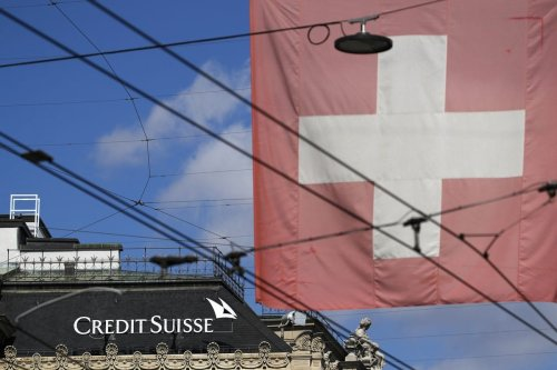 A Swiss national flag in Zurich, Switzerland, on Thursday, 8 April 2021 [Stefan Wermuth/Bloomberg/Getty Images]