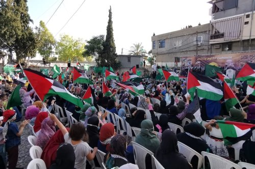 Palestinian refugees hold Palestinian flags during a demonstration in support of Palestinians in Gaza City, at Ain al-Hilweh Refugee Camp in Sidon, Lebanon on May 30, 2021. [Ali Hankir - Anadolu Agency]
