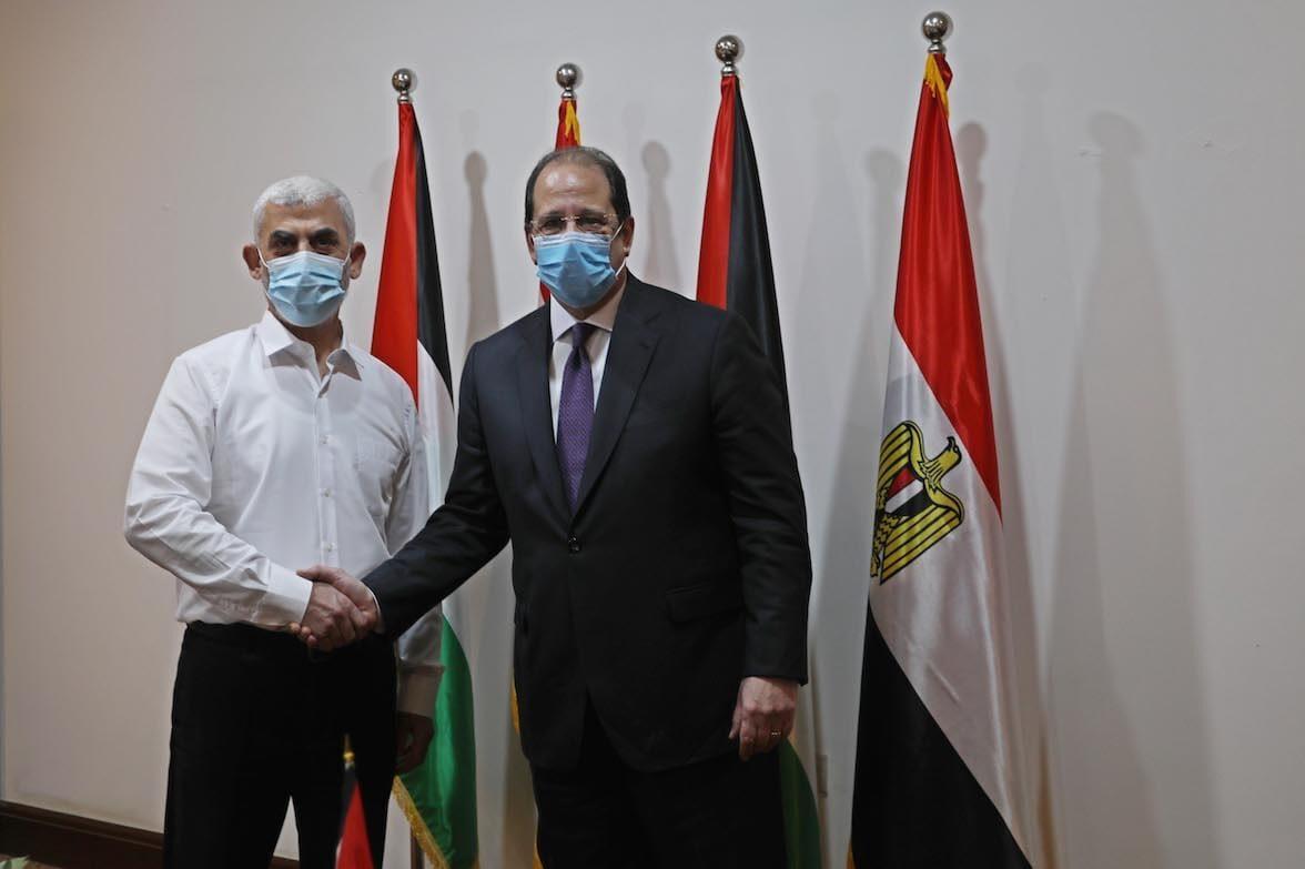 Head of the Egyptian Intelligence Service Abbas Kamil (R) meets Hamas' Gaza chief Yahya Sinwar (L) in Gaza City, Gaza on 31 May 2021. [Ashraf Amra - Anadolu Agency]