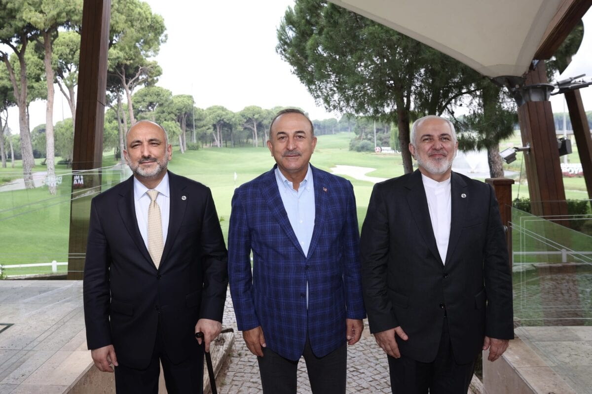 Turkish Foreign Minister Mevlut Cavusoglu (C) meets Iranian Foreign Minister Javad Zarif (R) and Afghan Foreign Minister, Mohammad Hanif Atmar (L)within the Antalya Diplomacy Forum at NEST International Convention Center in Antalya, Turkey on June 20, 2021 [Fatih Aktaş/Anadolu Agency]