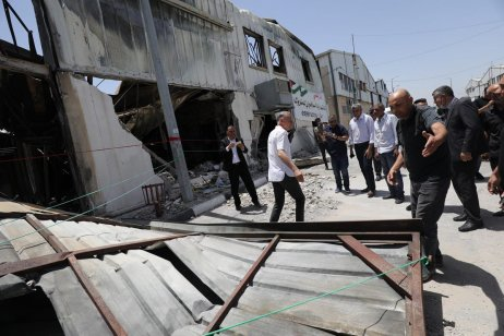 Officials inspect the ruins of the Gaza Industrial City which was destroyed by air strikes by Israel, 10 June 2021 [Mohammed Asad/Middle East Monitor]