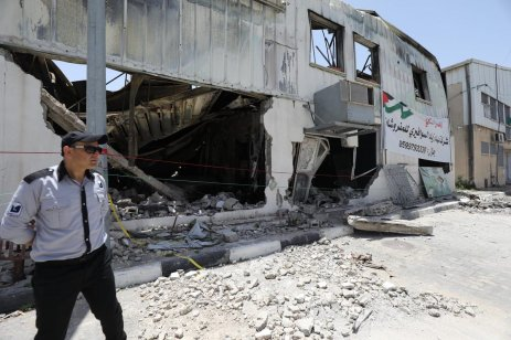 Officials inspect the ruins of the Gaza Industrial City which was destroyed by Israel's air strikes, 10 June 2021 [Mohammed Asad/Middle East Monitor]