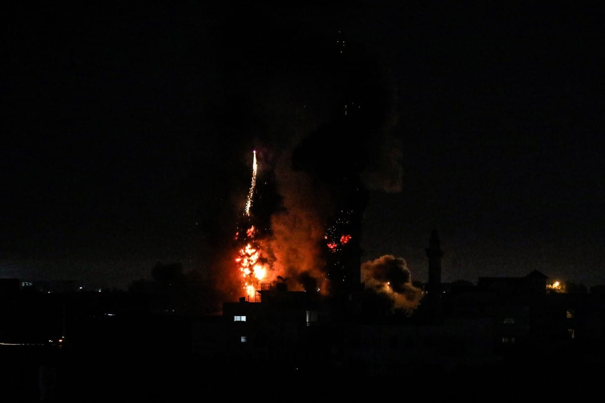 Flames are seen after an Israeli air strike hit Gaza on 15 June 2021 [Ali Jadallah/Anadolu Agency]