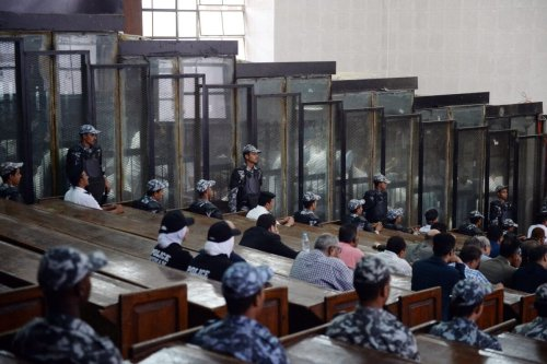 This picture shows the courtroom and soundproof glass dock (bottom) during the trial of 700 defendants including Egyptian photojournalist Mahmoud Abu Zeid, widely known as Shawkan, in the capital Cairo, on September 8, 2018 [MOHAMED EL-SHAHED/AFP via Getty Images]