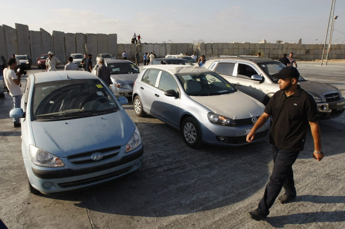 Palestinian officials inspect cars which arrived in Rafah through the Kerem Shalom crossing between Israel and the southern Gaza Strip on September 20, 2010 [SAID KHATIB/AFP via Getty Images]