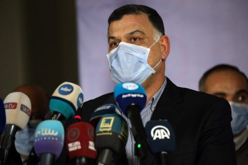Khaled Mazen, undersecretary of the Interior Ministry of Libya's UN-recognised Government of National Accord (GNA) and member of the high committee to combat COVID-19 coronavirus pandemic, speaks during a coronavirus-related press conference in the capital Tripoli on April 15, 2020. (Photo by Mahmud TURKIA / AFP) (Photo by MAHMUD TURKIA/AFP via Getty Images)