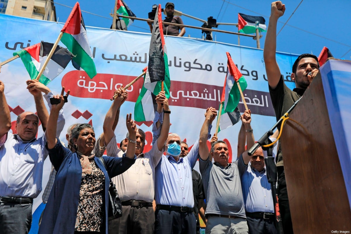 """Hamas leader Yahya Sinwar (4th L) takes part in a rally as Palestinians call for a """"Day of Rage"""" to protest Israel's plan to annex parts of the occupied West Bank, in Gaza City on July 1, 2020 [MAHMUD HAMS/AFP via Getty Images]"""