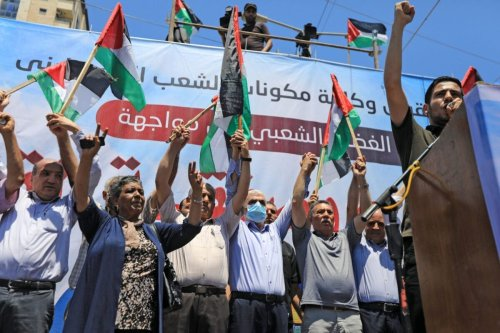 """Hamas leader Yahya Sinwar takes part in a rally as Palestinians call for a """"Day of Rage"""" to protest Israel's plan to annex parts of the occupied West Bank, in Gaza City on July 1, 2020 [MAHMUD HAMS/AFP via Getty Images]"""