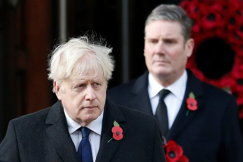 Britain's Prime Minister Boris Johnson (L) and Britain's main opposition Labour Party leader Keir Starmer in central London, on November 8, 2020. [PETER NICHOLLS/POOL/AFP via Getty Images]
