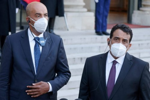 Libya's interim leaders Musa al-Koni (L) and Mohamed El-Menfi talk to the press after their meeting with the French President at the Elysee presidential Palace in Paris on March 23, 2021 [LUDOVIC MARIN/AFP via Getty Images]
