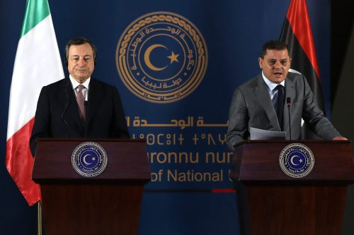 Libya's interim prime minister Abdul Hamid Dbeibah (R) and Italian Prime Minister Mario Draghi (L) give a joint press conference at the prime minister's office in Libya's capital Tripoli on April 6, 2021 [MAHMUD TURKIA/AFP via Getty Images]