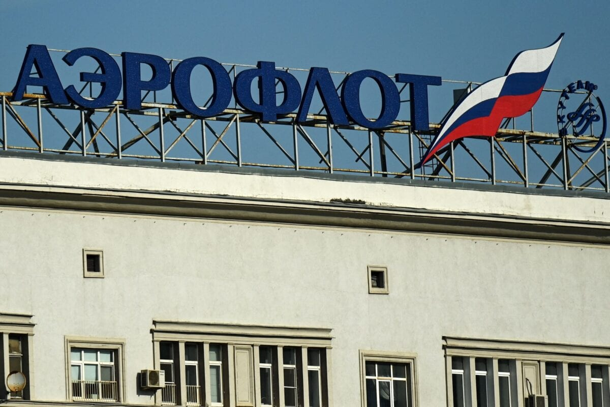 The logo of Russia's airline Aeroflot is seen on top of a building in central Moscow on April 12, 2021 [KIRILL KUDRYAVTSEV/AFP via Getty Images]