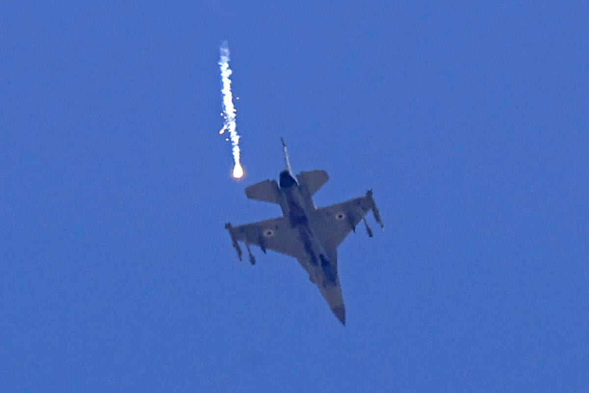 An Israeli F-16 fighter jet releases flare near Sderot, in southern Israel on the border with the Hamas-controlled Gaza Strip, on May 14, 2021 [JACK GUEZ/AFP via Getty Images]