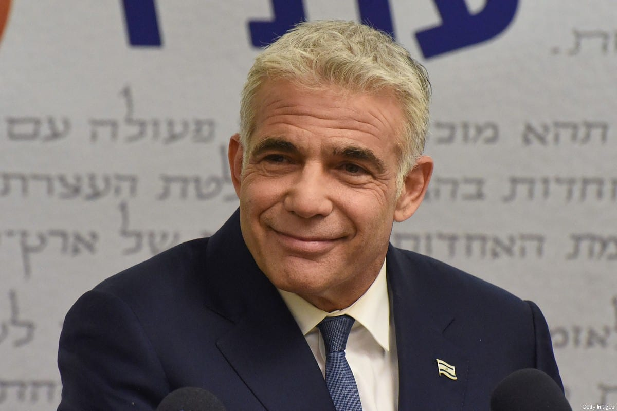 """Israel's centrist opposition leader Yair Lapid delivers a statement to the press at the Knesset (Israeli parliament) in Jerusalem on May 31, 2021. - Lapid said """"many obstacles"""" remain before a diverse coalition to oust long-serving right-wing Prime Minister Benjamin Netanyahu can be agreed. (Photo by DEBBIE HILL / POOL / AFP) (Photo by DEBBIE HILL/POOL/AFP via Getty Images)"""