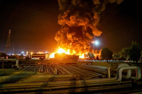 A picture taken late on June 2, 2021, shows fire raging at an oil refinery in the Iranian capital Tehran. [VAHID AHMADI/TASNIM NEWS/AFP via Getty Images]