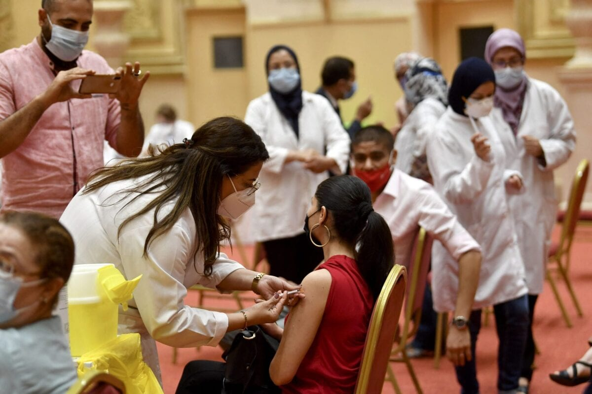 Tunisians working in the tourism industry receive a dose of the Pfizer-BioNTech COVID-19 coronavirus vaccine on June 4, 2021 in Tunis [FETHI BELAID/AFP via Getty Images]