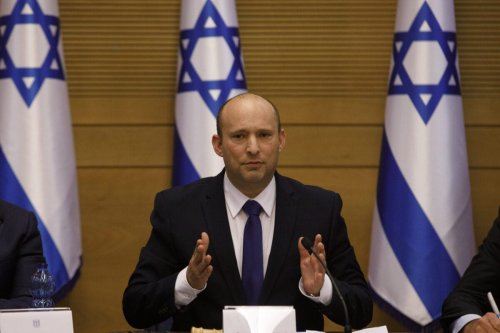 Naftali Bennett, Israeli's new prime minister and leader of the Yamina party, speaks during a meeting of the new government at the Knesset in Jerusalem, Israel, on Sunday, June 13, 2021 [Kobi Wolf/Bloomberg via Getty Images]