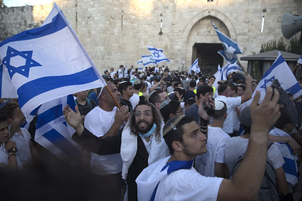 Far right Israeli prays during the flag March at Damascus Gate on 15 June 2021 in Jerusalem, Israel. [Amir Levy/Getty Images]
