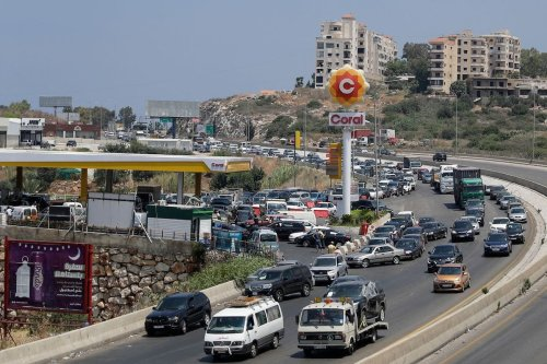 Vehicles on the lane adjacent to the petrol station queue-up for fuel in Saadiyat on the Beirut-Sidon highway, south of the Lebanese captial on 24 June 2021 amidst severe fuel shortages. [JOSEPH EID/AFP via Getty Images]