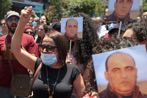 Protesters take part in a demonstration calling for Palestinian president Mahmud Abbas to quit in Ramallah in the occupied West Bank on June 24, 2021, following the death of Palestinian human rights activist Nizar Banat [ABBAS MOMANI/AFP via Getty Images]