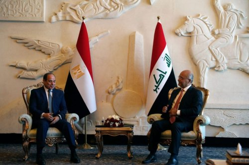 Iraqi President Barham Salih (R) receives his Egyptian counterpart Abdel Fattah al-Sisi at Baghdad Airport in the capital on June 27, 2021 [AHMAD AL-RUBAYE/AFP via Getty Images]