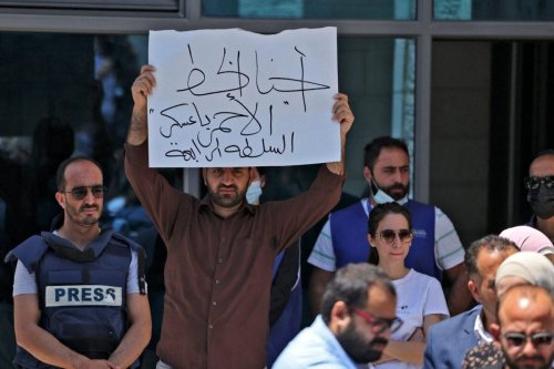 Journalists protest outside the United Nations office in the occupied West Bank city of Ramallah on June 28, 2021 [ABBAS MOMANI/AFP via Getty Images]