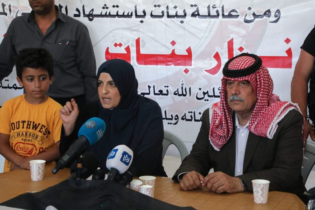 The wife of Palestinian political activist Nizar Banat, Jihan, speaks during a press conference at the family home in Dura south of Hebron city in the occupied West Bank, on June 28, 2021 [MOSAB SHAWER/AFP via Getty Images]