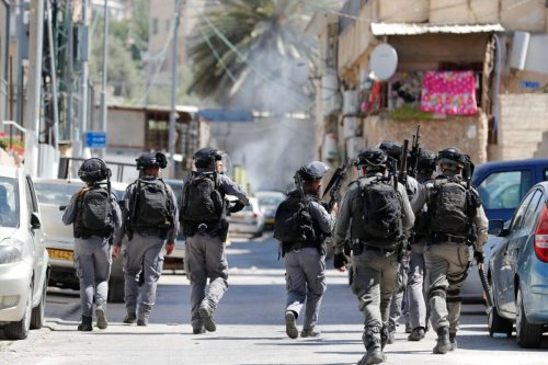 Israeli security officers deploy after firing tear gas during clashes with Palestinian residents as Israeli authorities demolish shops in Israeli-annexed east Jerusalem's predominantly Arab neighbourhood of Silwan, on June 29, 2021 [AHMAD GHARABLI/AFP via Getty Images]