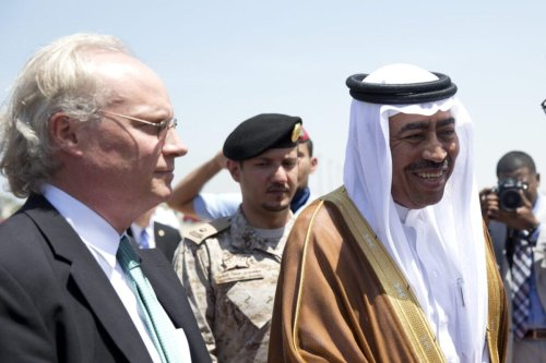 JEDDAH, SAUDI ARABIA - JULY 22: U.S. Defense Secretary Ash Carter is greeted by Saudi Arabian Assistant Minister of Defense Mohammad Al-Ayesh, center, and U.S. Embassy Deputy Chief of Mission Tim Lenderking, left, as he arrives on a E4-B military aircraft at King Abdulaziz International Airport on July 22, 2015 in Jeddah, Saudi Arabia. Carter is meeting with Saudi King Salmon and other Saudi officials. (Photo by Carolyn Kaster - Pool/Getty Images)