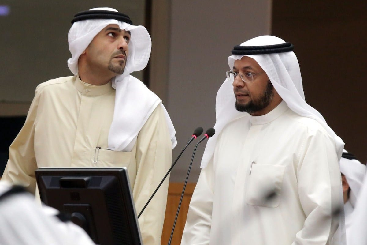 Under-Secretary of Kuwait's ministry of finance Khalifa Hamada (R) speaks as Kuwaiti Finance Minister Anas al-Saleh looks on during a parliament session at the Kuwaiti national assembly in Kuwait City on 20 May 2014. [YASSER AL-ZAYYAT/AFP via Getty Images]