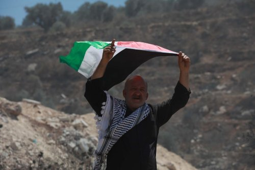 Palestinians protest against illegal Israeli settlements in Beita district of Nablus, West Bank on July 02, 2021 [İssam Rimawi / Anadolu Agency]