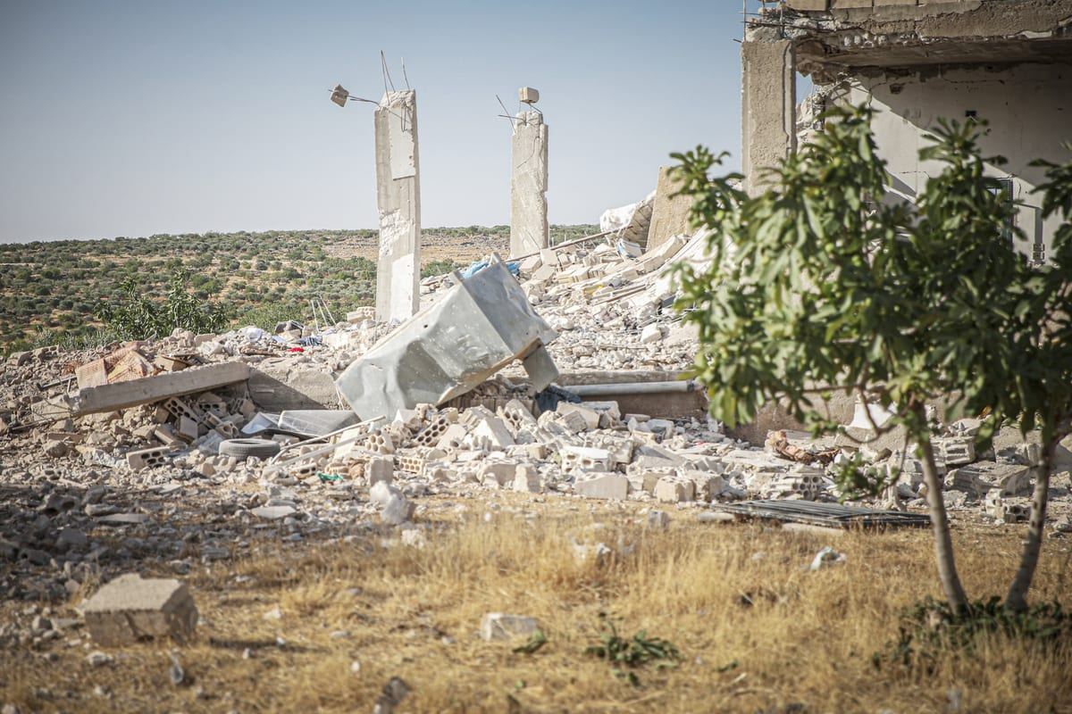 IDLIB, SYRIA - JULY 3: A damaged building is seen after the attacks by forces of the Bashar al-Assad regime and their allied Iran-backed foreign terrorist groups in a de-escalation zone in northwestern Syrian province of Idlib on July 3, 2021. Regime forces fired shells at the villages of Mashun, Iblin and Balyun in southern Idlib, violating a cease-fire deal in the de-escalation zone. ( Muhammed Said - Anadolu Agency )