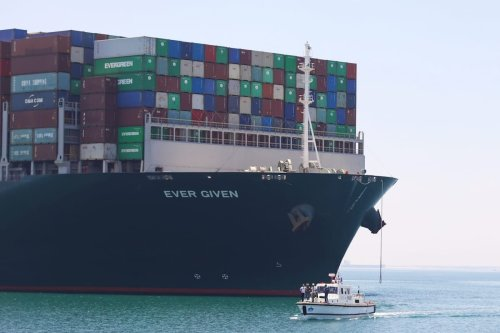 EGYPT - JULY 7: The Panama-flagged ship Ever Given set sail towards the northeastern Egyptian city of Ismailia for its departure from the Suez Canal and resumption of its voyage to the Dutch city of Rotterdam, on July 7, 2021. Following a deal between the company and canal authorities, an Egyptian court on Tuesday ordered the release of the container ship that blocked the Suez Canal in March for nearly a week as it was stuck in its banks, local media reported. ( Stringer - Anadolu Agency )