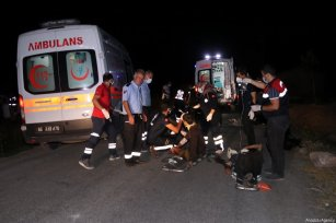 View of the crash scene as at least 12 people were killed after a minibus carrying illegal migrants crashed Sunday in the Muradiye district of Van province on July 11, 2021 [Necmettin Karaca / Anadolu Agency]