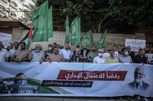 Mohammed al-Ghul (C), one of Hamas executives, makes a speech during a protest against Israeli policy of administrative detention in front of building of International Committee of the Red Cross (ICRC) in Gaza City, Gaza on July 12, 2021 [Ali Jadallah/Anadolu Agency]