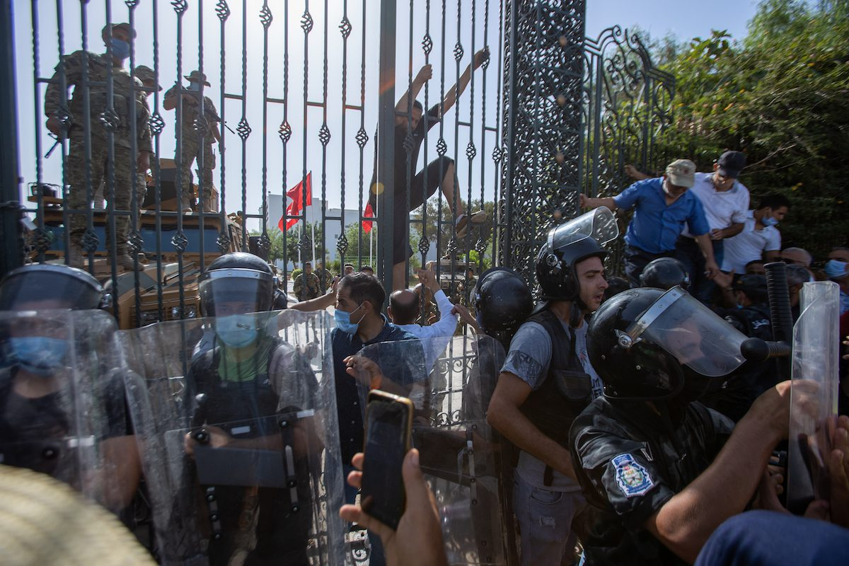 Security forces take security measures around parliament building as supporters and opponents of coup gather in front of parliament building after Tunisian President Kais Saied announced late Sunday that he has fully assumed executive authority in addition to suspending parliament in Tunis, Tunisia on 26 July 2021. [Nacer Talel - Anadolu Agency]