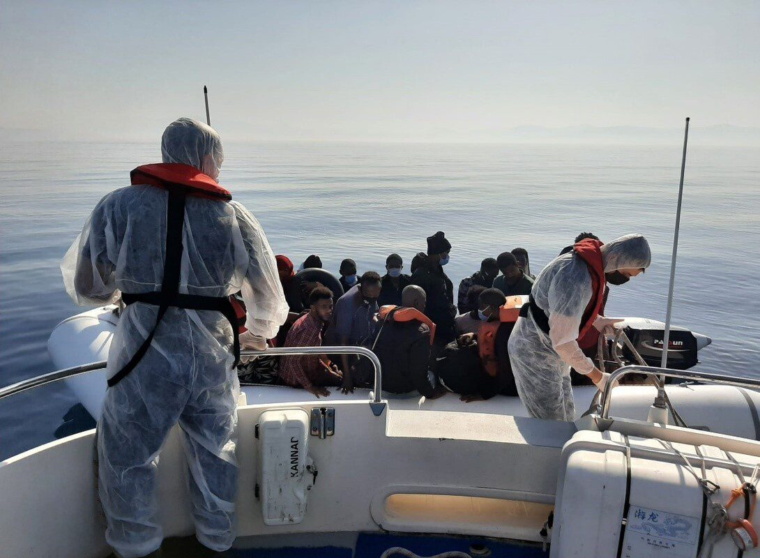 Turkish Coast Guards pick up 388 asylum seekers on a boat off Izmir's coast, while 2 others were detained over allegations of organising the illegal crossing, in Turkey on July 27, 2021 [Turkish Coast Guard / Anadolu Agency]